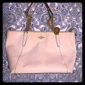 Cream Coach bag with gold chain straps